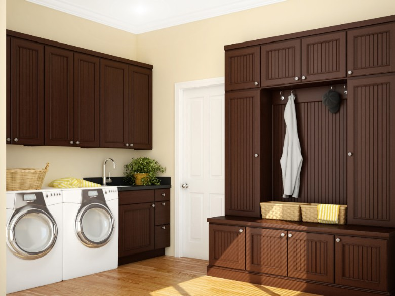 Sarasota Luandry Room With Dark Chocalate Cabinets, Wood Floor And White  Appliances.